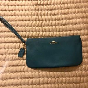 Coach large wristlet in forest/ emerald green.